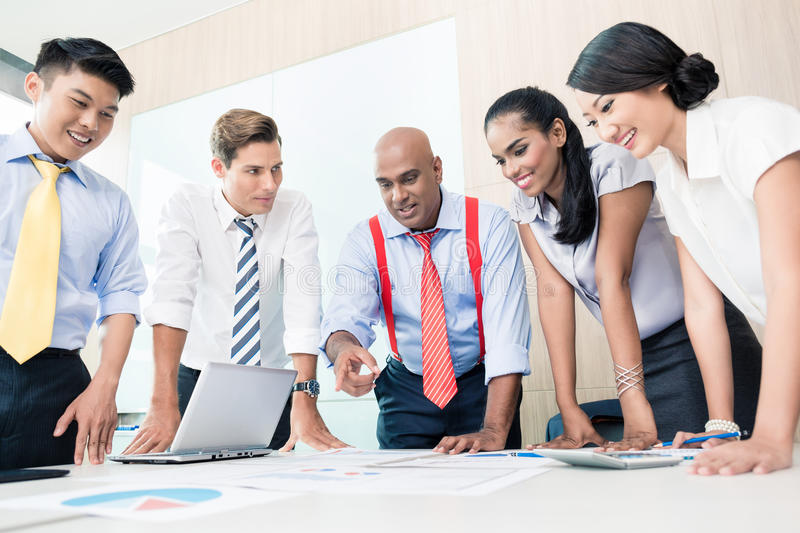 Asian business team in strategy meeting stock images