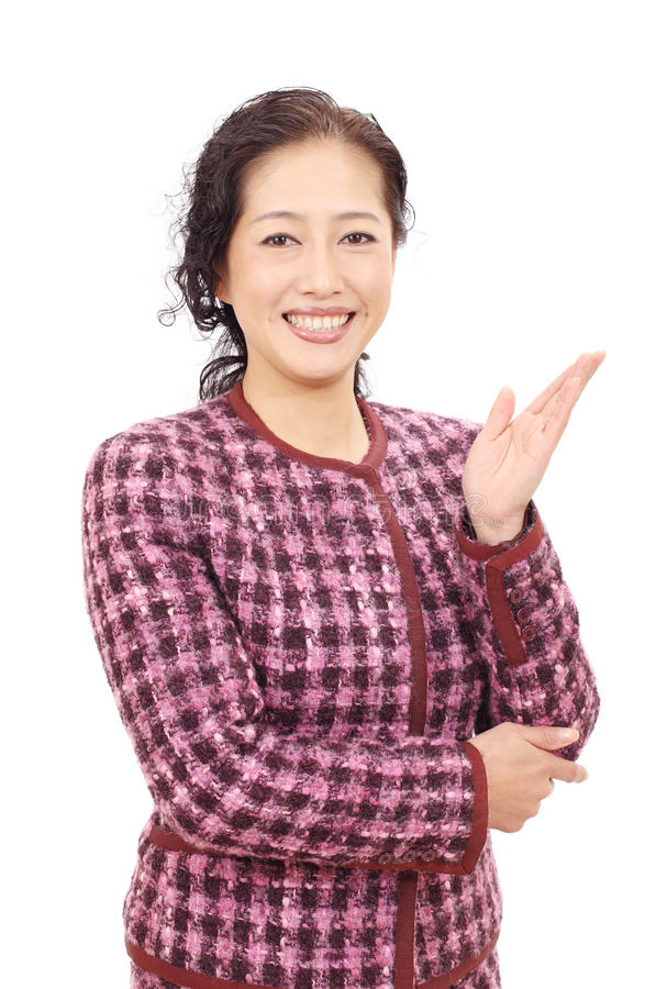 Asian business woman. Hand showing blank sign royalty free stock photography