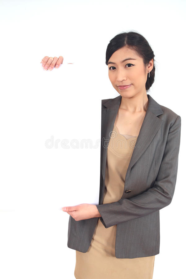 Asian business woman. Holding a blank billboard on white royalty free stock image
