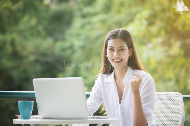 Asian business woman arms up for Celebration Success Working ,Successful Concept royalty free stock photo