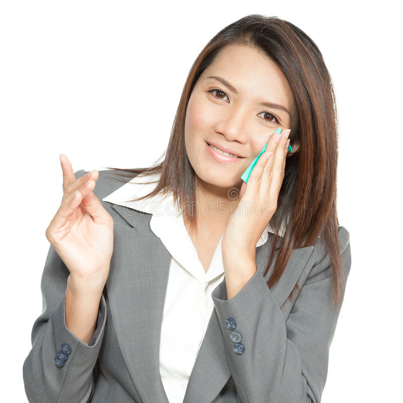 Asian business woman beautiful young pretty using facial tissue royalty free stock images