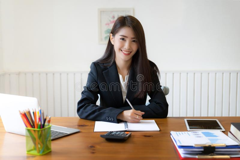 Asian business woman executives discussing financial reports stock image