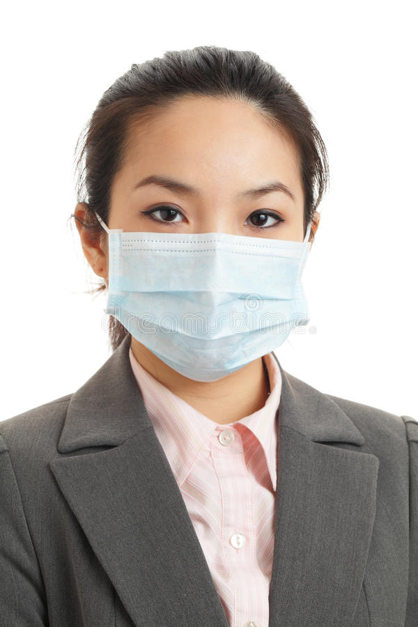 Asian business woman with face mask. Isolated on white royalty free stock photography