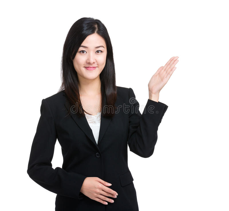 Asian business woman with hand presentation. Isolated on white stock image