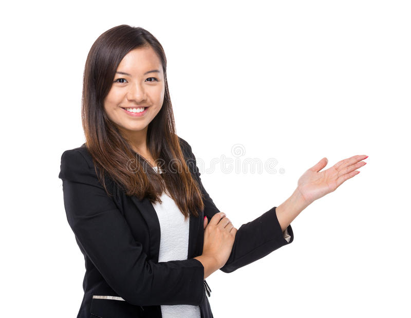 Asian business woman with hand presentation. Isolated on white royalty free stock photo