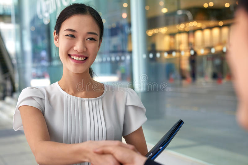 Asian business woman handshake stock photos