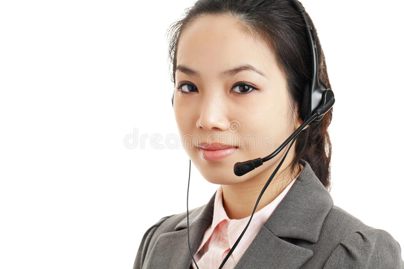 Asian business woman with headset. Isolated on white background stock image