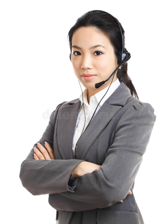 Asian business woman with headset. Over white background stock image