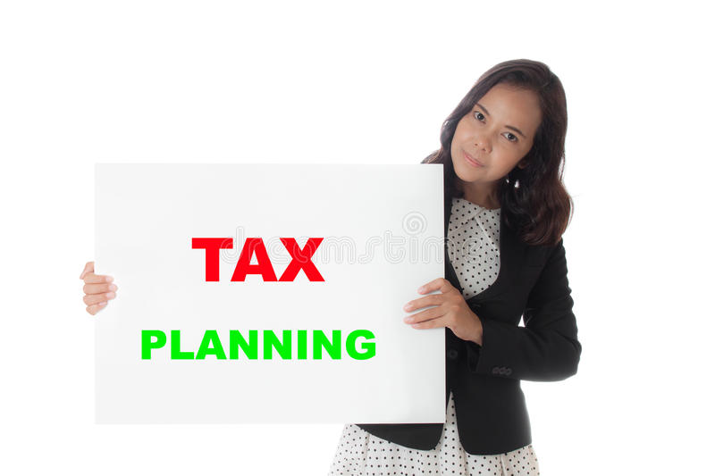 Asian business woman holding a banner with tax planning text. Isolated on white background royalty free stock photos