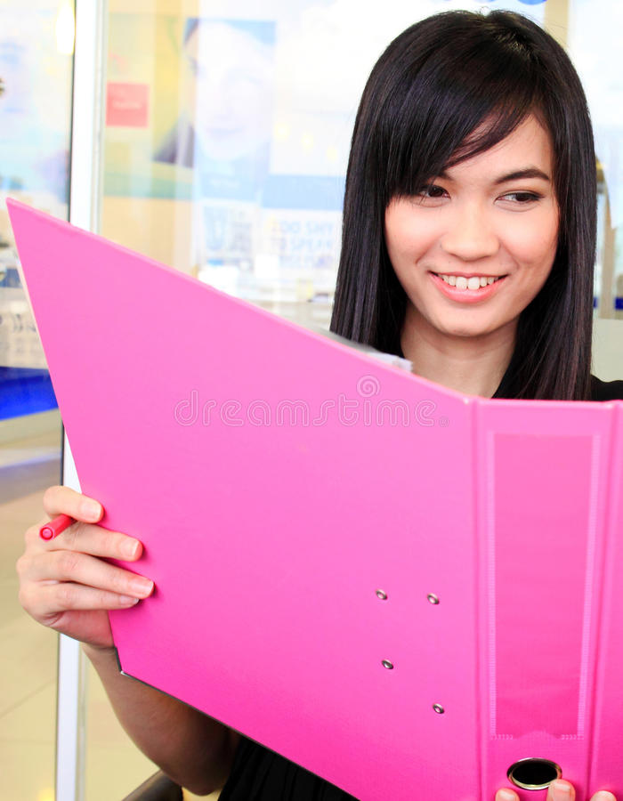 Asian business woman holding document file