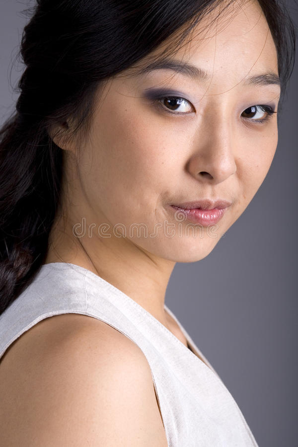 Free Asian Business Woman In Suit Eyes To Camera Stock Photos - 18234603