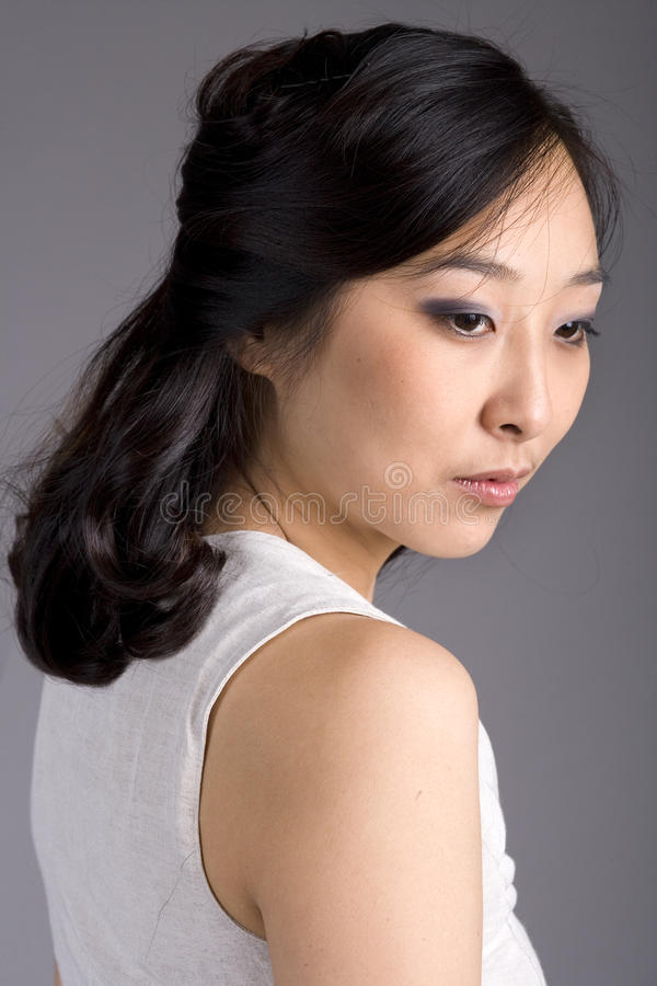 Free Asian Business Woman In Suit Looking Away Stock Photos - 18234613