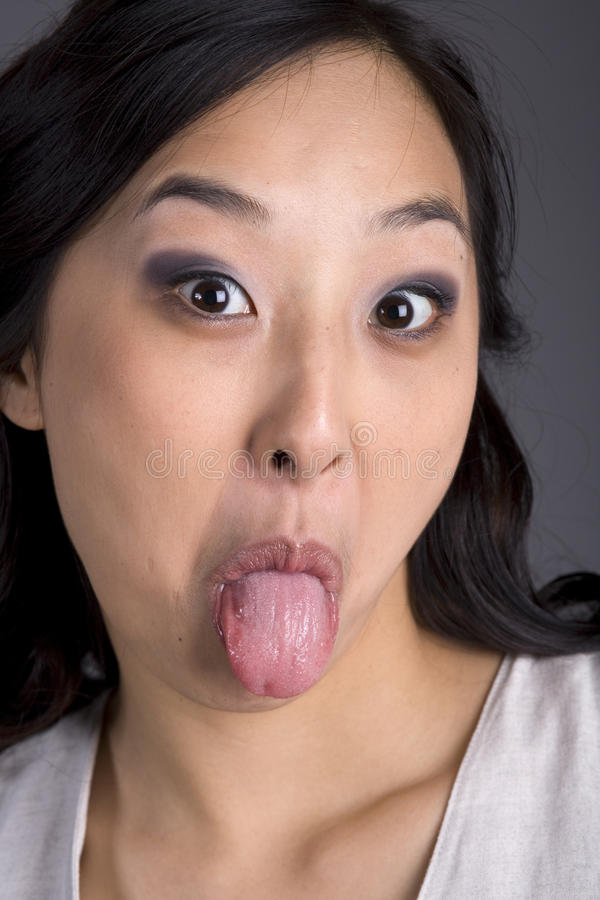 Free Asian Business Woman In Suit Tongue Out Royalty Free Stock Images - 18234599