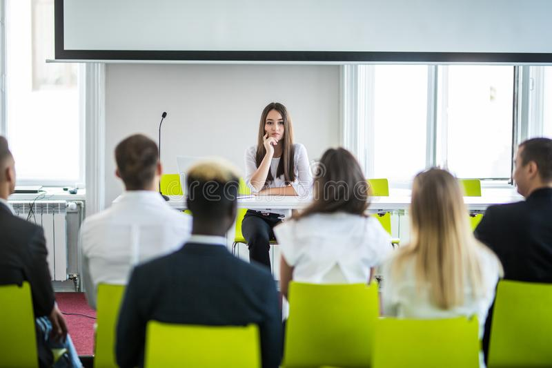 Asian business woman leader presenting work to mixed race colleagues in the meeting. Conference concept stock image