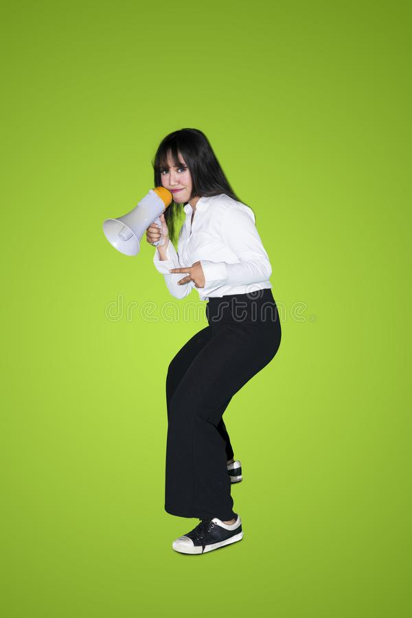 Asian business woman with megaphone royalty free stock photo