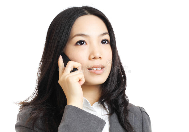 Asian business woman on phone call. Isolated on white background stock image