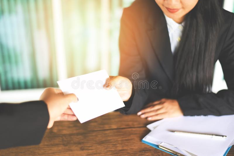 Asian business woman receiving salary bonus money from boss or manager at office happily - Yearly Bonus concept for encouragement stock photography