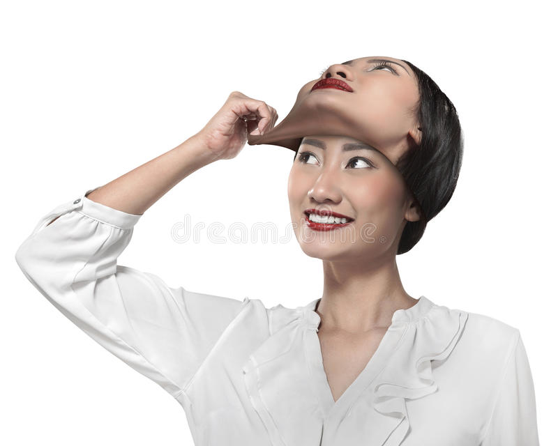 Asian business woman remove his other face mask. Changing mood concept royalty free stock image