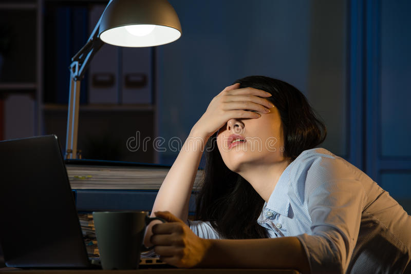 Asian business woman sleepy working overtime late night stock images