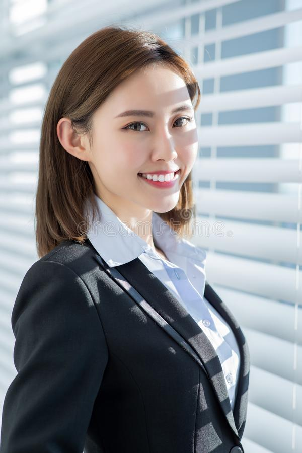 Asian business woman smile at you stock photo