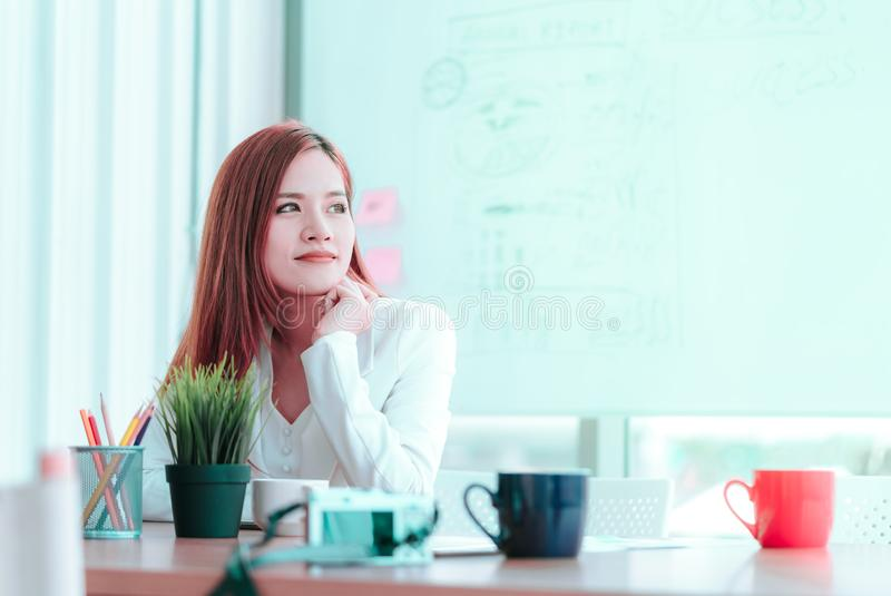 Business woman smiling wondering over success ideas royalty free stock photo
