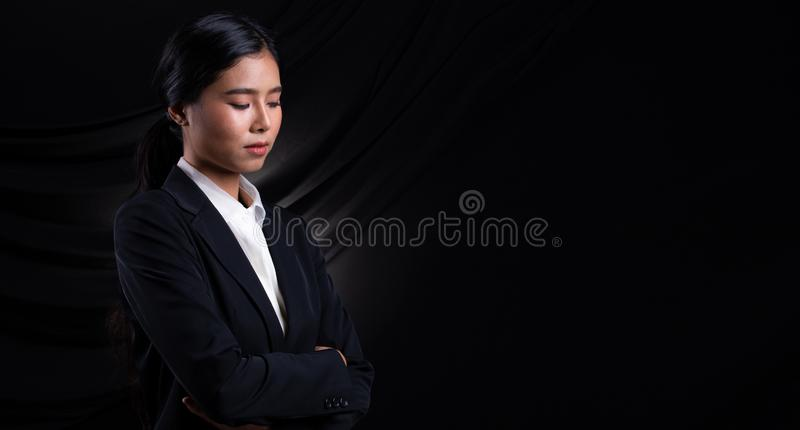 Asian Business Woman Stand in dark Formal Suit. Portrait Asian Business Woman dark blue Formal proper Suit, studio lighting black drape fabric background stock image