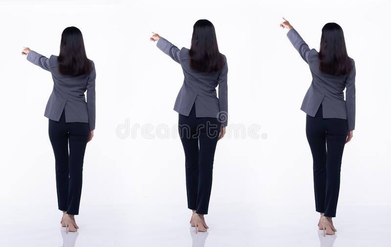 Asian Business Woman Stand in White Formal Suit. Full Length Snap back view, Asian Business Woman stand in Blue Formal proper Suit pants and high heel shoes stock images