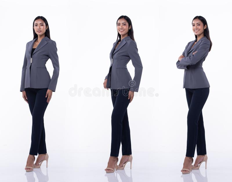 Asian Business Woman Stand in White Formal Suit. Full Length Snap Figure, Asian Business Woman Stand in Blue Formal proper Suit pants and high heel shoes, studio royalty free stock images