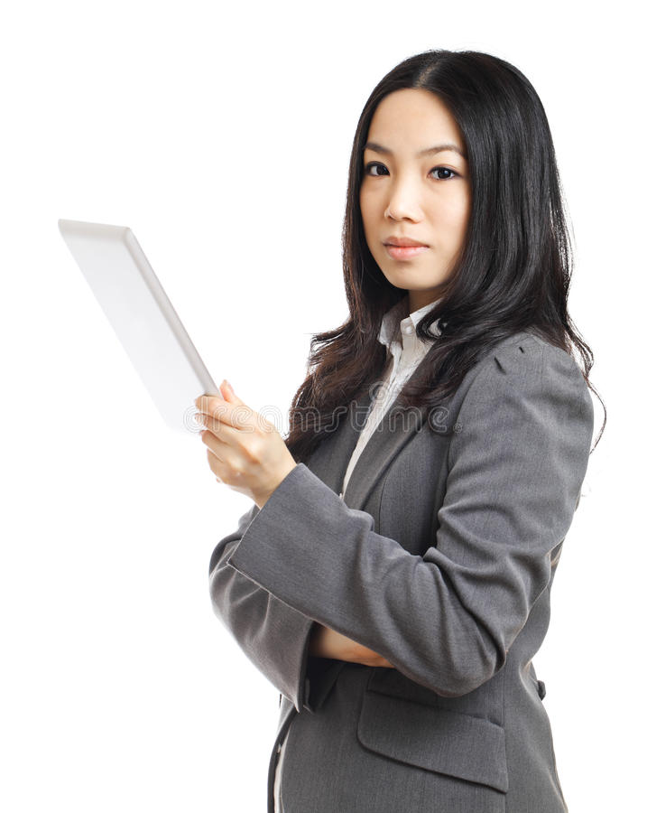 Asian business woman with tablet. Over white background royalty free stock images