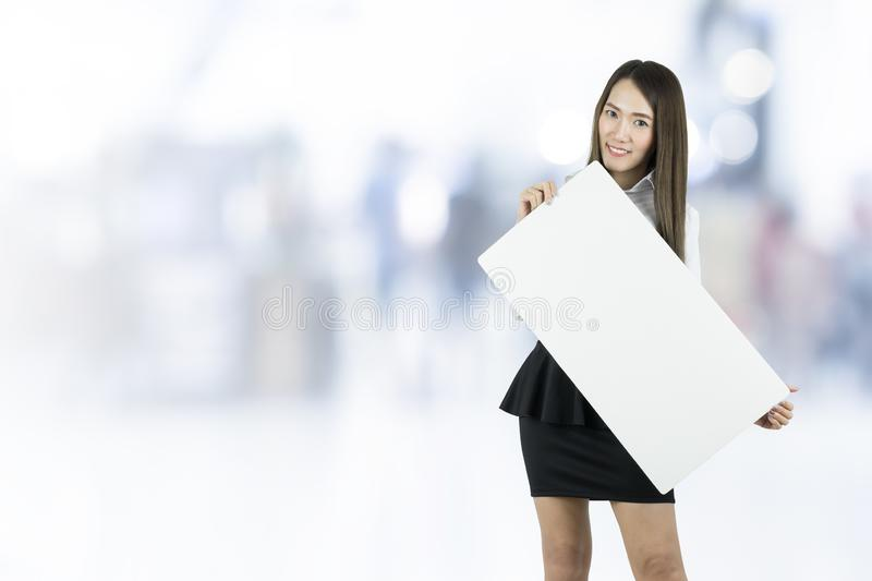 Asian business woman taking blank whiteboard. royalty free stock images