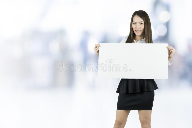 Asian business woman taking blank whiteboard. stock images