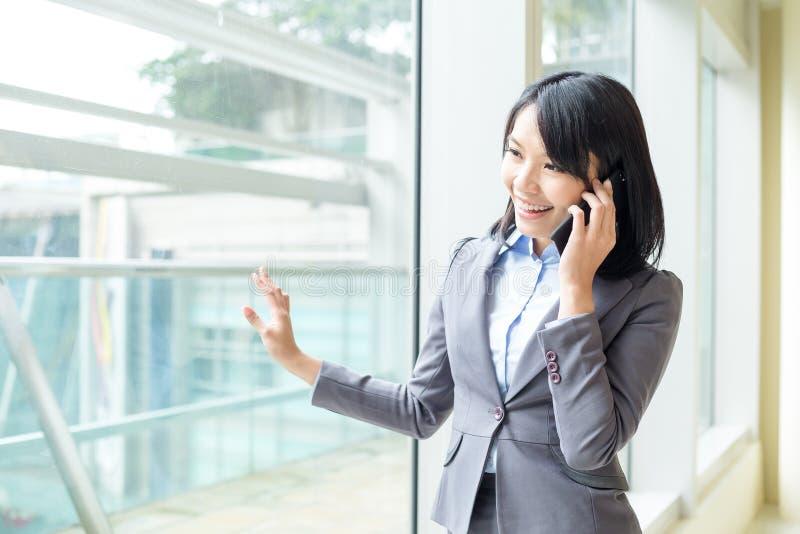 Asian business woman talk to cellphone stock photos