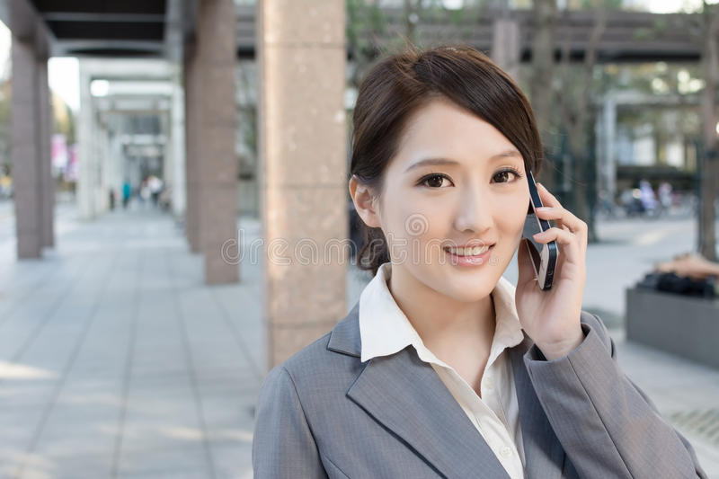Asian business woman talking on smartphone with copyspace stock photo