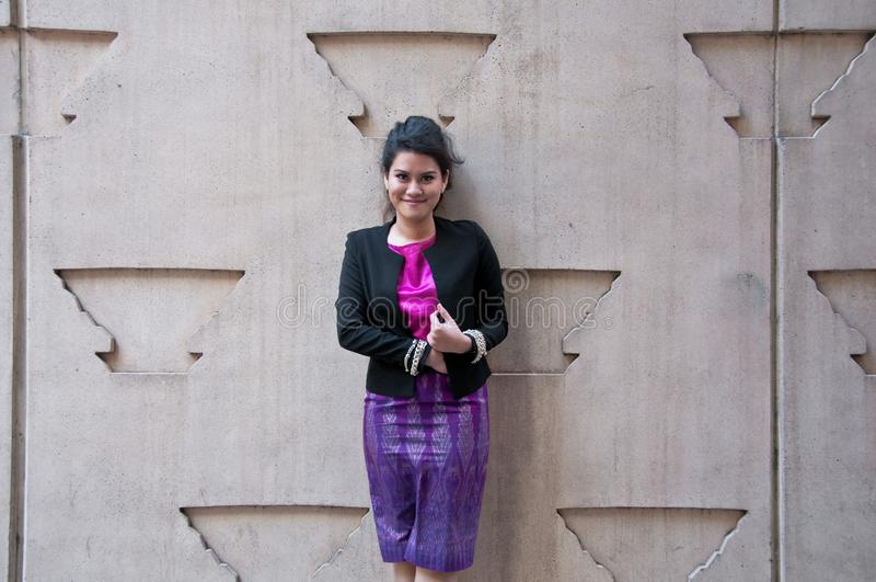 Asian business woman with Thai silk purple dress royalty free stock image