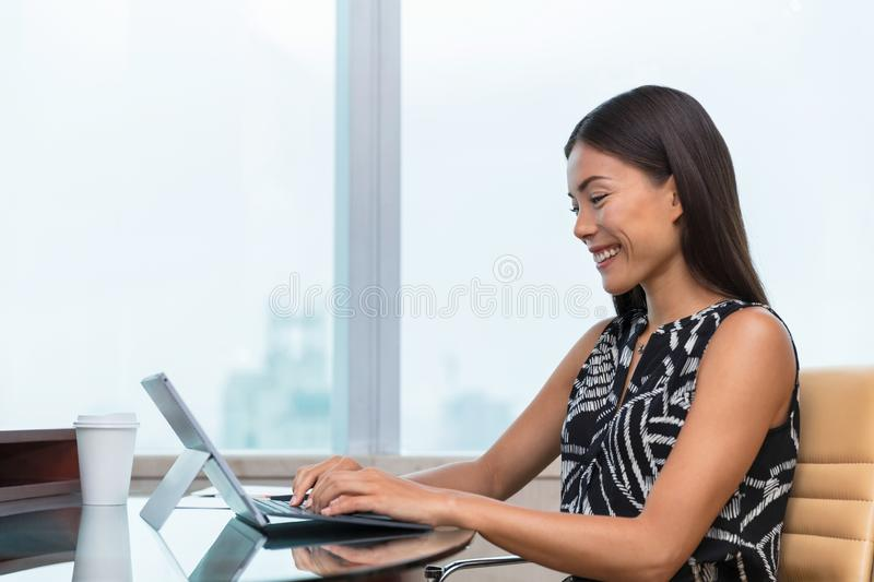 Asian business woman typing on laptop writing online working at office desk. Freelance remote work at home or customer service. Support. Businesswoman lifestyle stock images