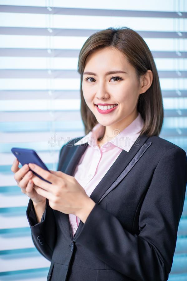 Asian business woman use smartphone royalty free stock photography