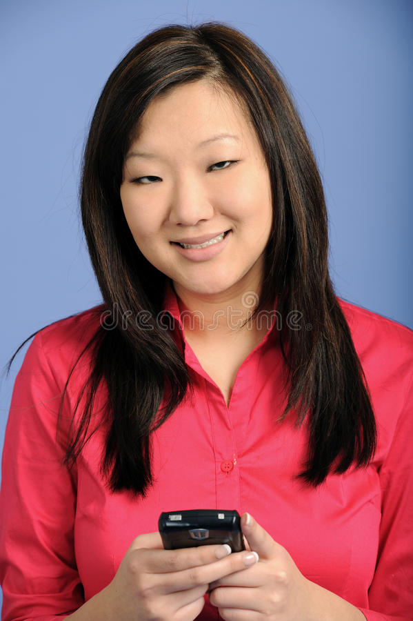 Download Asian Business Woman Using A PDA Stock Image - Image: 18604049