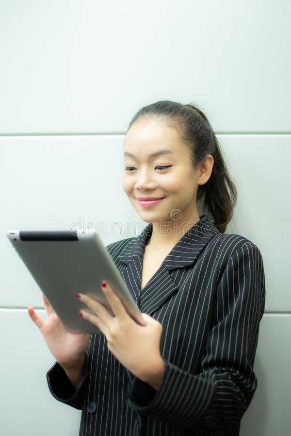 An asian business woman is using tablet stock photo