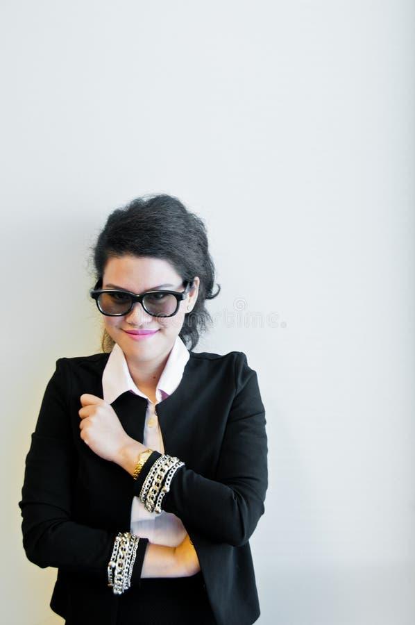 Business woman wear fashion sun glasses on white background. Asian business woman wear a black fashion sun glasses on white background stock photo