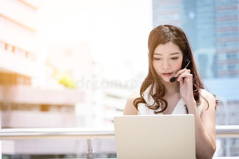 The asian business woman working and operation in outside office royalty free stock photography