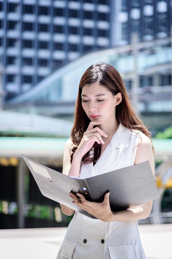 The asian business woman working and operation in outside office stock photography