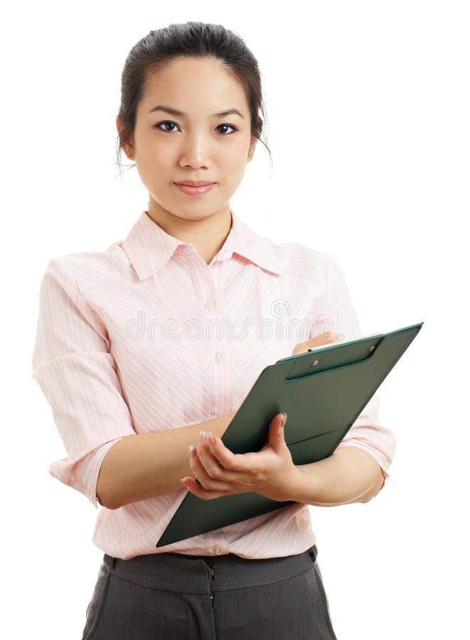 Asian business woman with writing pad. Isolated on white background royalty free stock photo