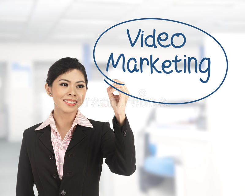 Asian business woman writing video marketing. On office background royalty free stock photo