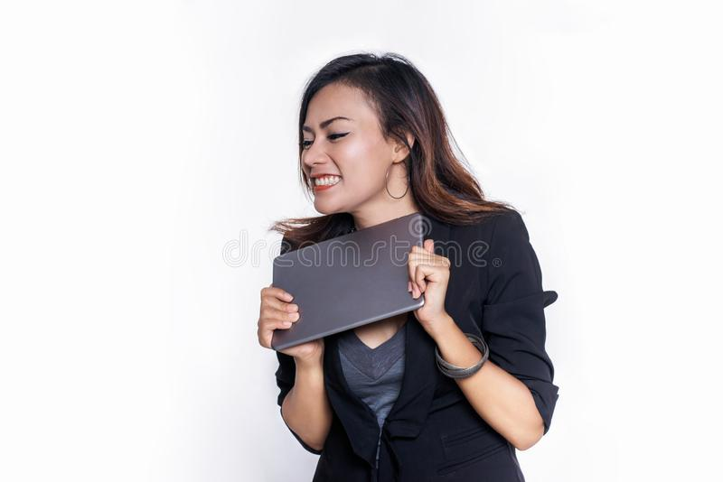 Asian business women are embracing her tablet and are happyFocus on face stock image