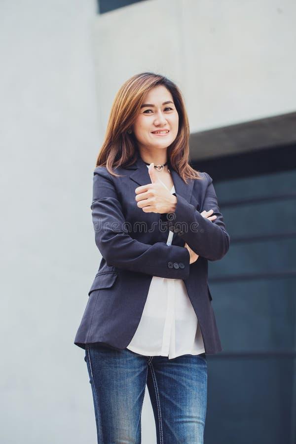 Asian business women thumb up royalty free stock photos