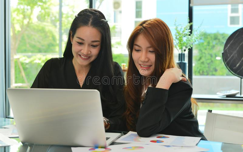 Asian business women working and using laptop in meeting room stock photos