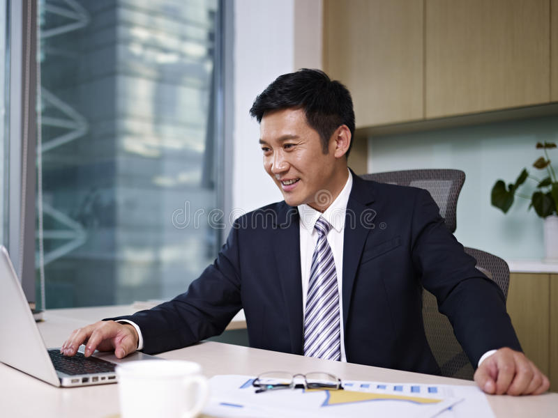 Asian businessman. Working in office stock photography