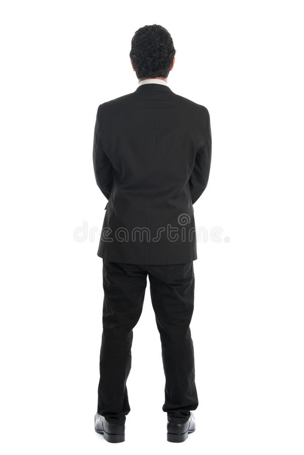 Asian businessman back view. Full body back view of young Southeast Asian businessman standing isolated on white background royalty free stock photo