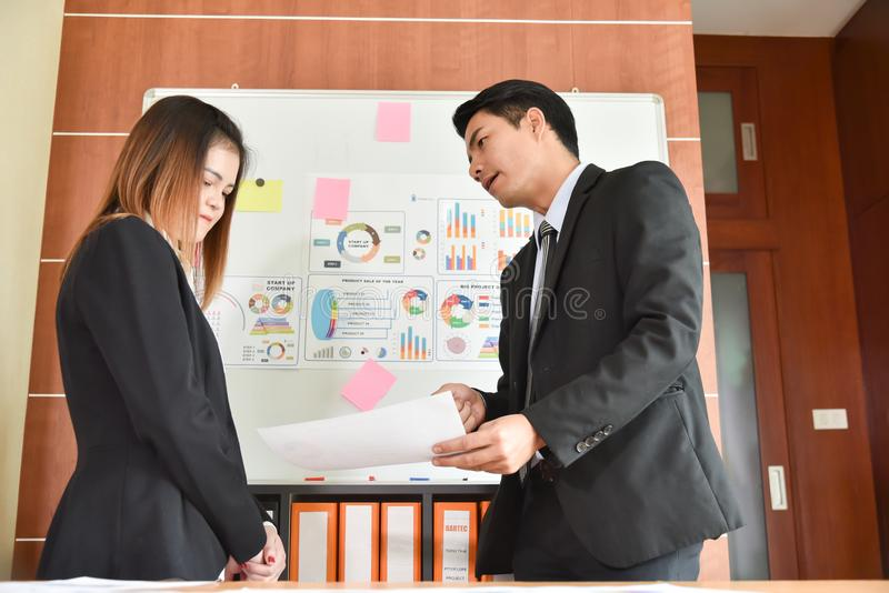 Asian Businessman is complaining to Businesswoman. royalty free stock photos