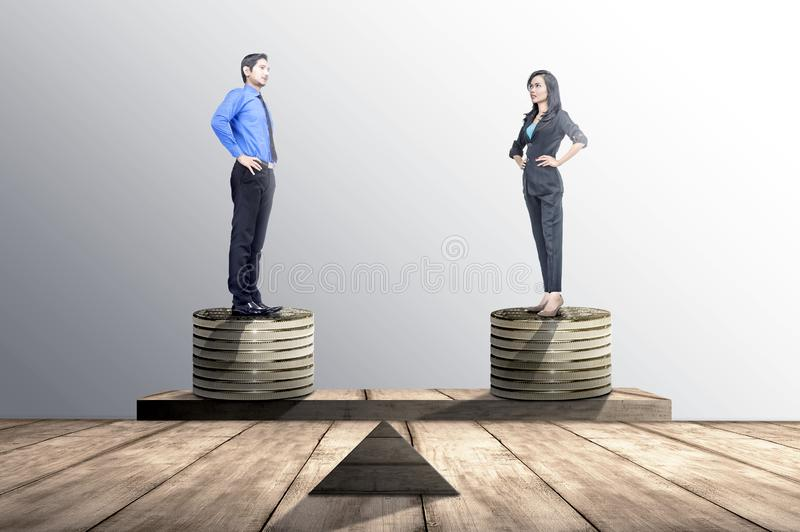 Asian businessman and businesswoman standing on coins stack with same height on balancer. Equality gender concept stock images